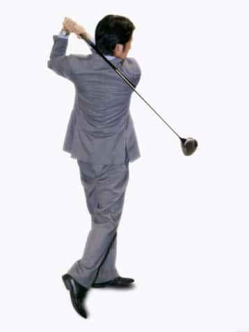 Lawyer in suit playing golf