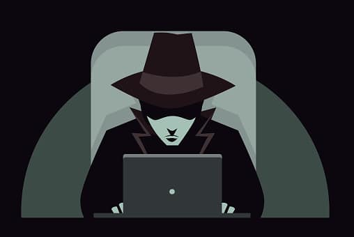 Man in Black Hat at Computer