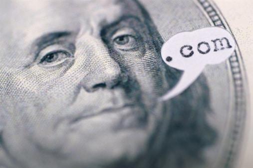 """Benjamin Franklin on bill says """".com"""""""