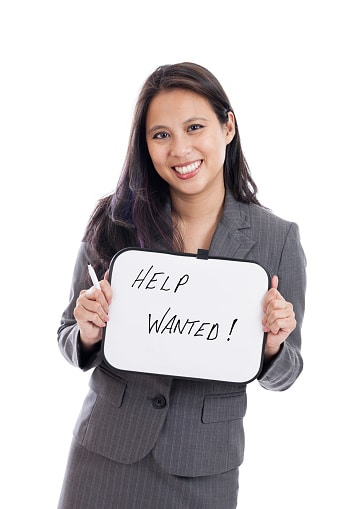 Lawyer Holding Help Wanted Sign